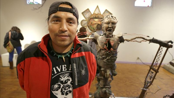 "Mexican-born sculptor Alfonso ""Piloto"" Nieves Ruiz poses with some of his creations during Chicago's Pilsen Open Studios 2012 event. (EFE)"